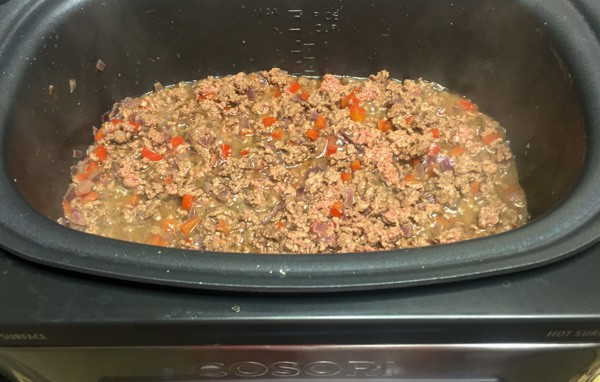 Ground meat cooking with the red peppers and onion in the Cosori