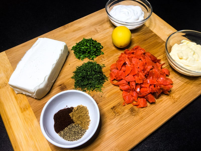 Ingredients for Smoked Salmon Dip on a wood cutting board.