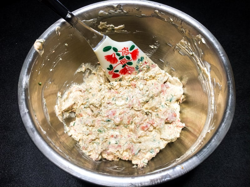 Mixing the ingredients for Smoked Salmon Dip in a stainless steel bowl.
