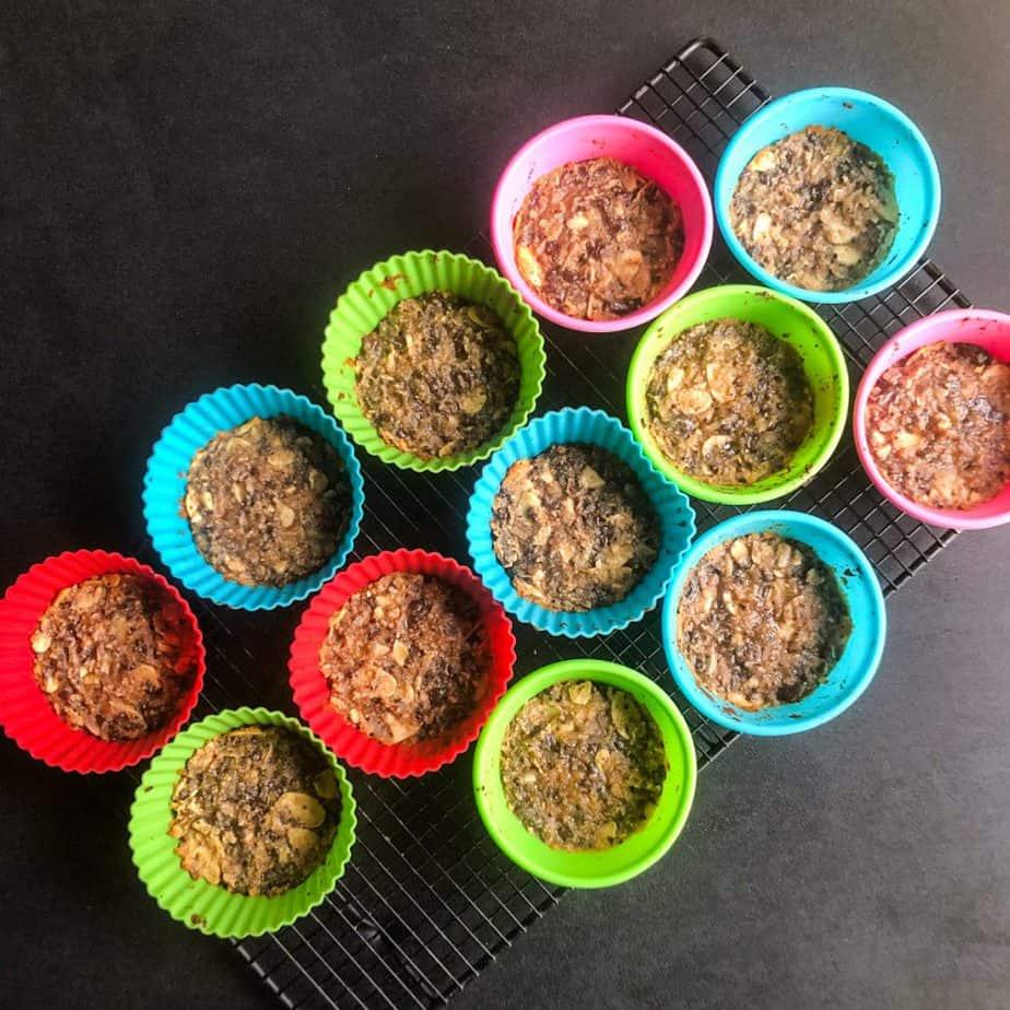 Almond Joy Treats in baking cups cooling on a baker's rack.