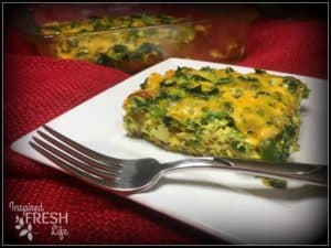 veggie and sausage breakfast casserole on a square white plate