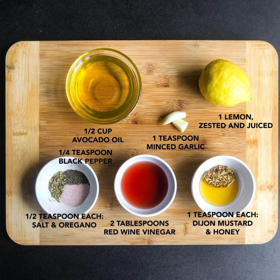 Ingredients portioned on a wood cutting board to make the salad dressing.