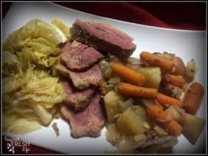 slow cooker corned beef and cabbage on a white platter
