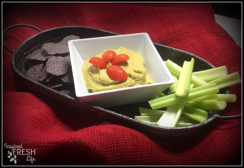 Avocado Hummus with celery sticks and blue corn tortilla chips