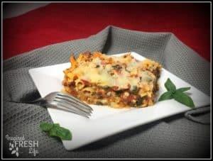 veggie chicken pasta on a square white plate