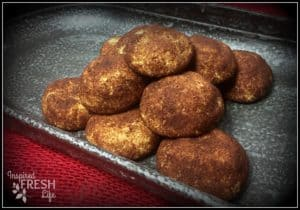 baked snickerdoodles on a tin platter