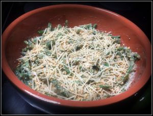 cleaned up green bean casserole in an earthware baking dish ready to go in the oven