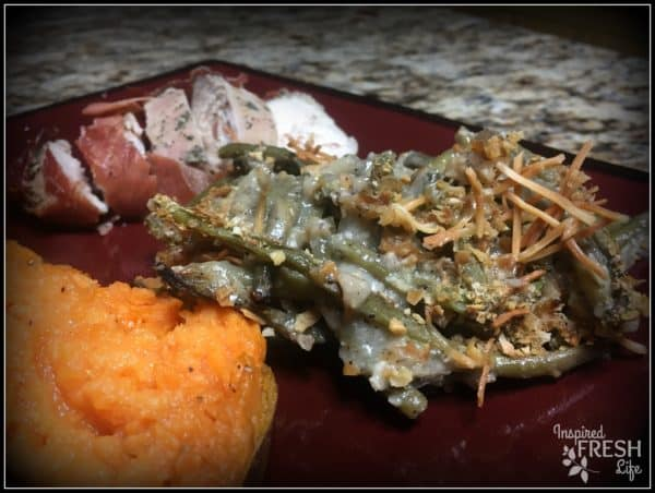 Green Bean Casserole on a red plate with Savory Sweet Potato Mash.