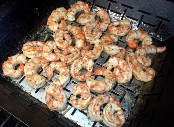 shrimp in a grill basket on the grill