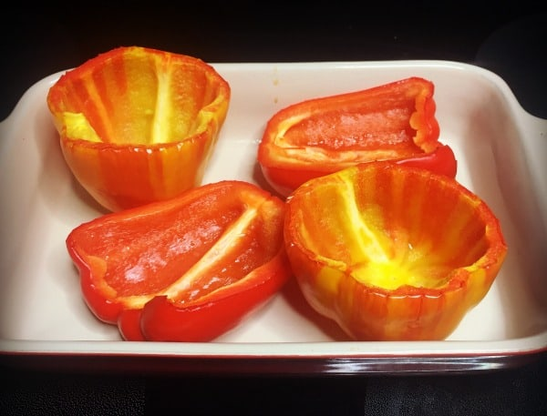 Pepper boats ready to be baked before stuffing them