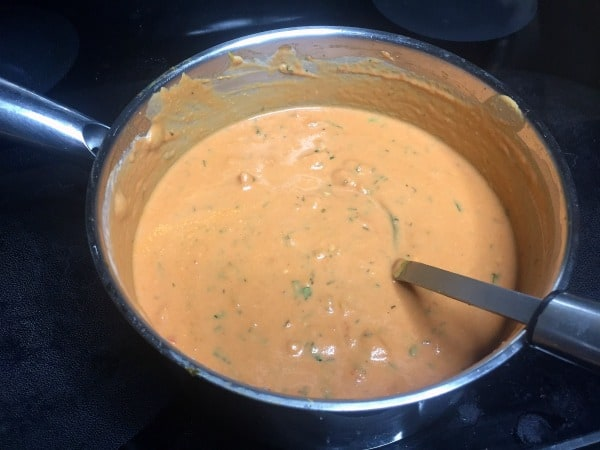 Butternut squash sauce cooking in a saute pan