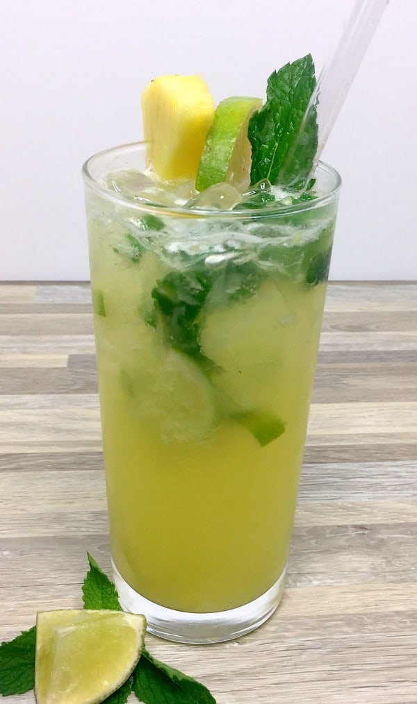 Pineapple mojito with pineapple, mint, and lime for garnish