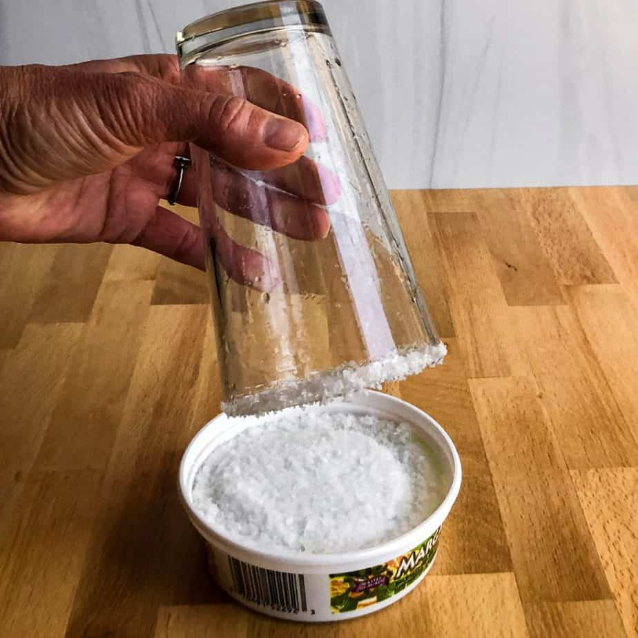 Hand dipping the glass into salt to add a rim.