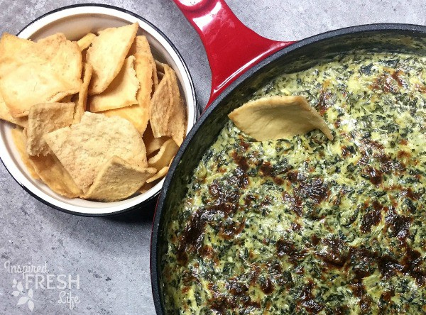 Close up of Easy Spinach Artichoke Dip with a bowl of pita chips
