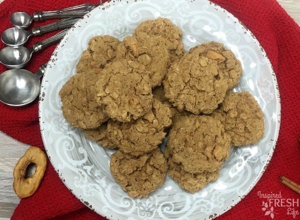 Apple Crisp Cookies stacked on a white plate