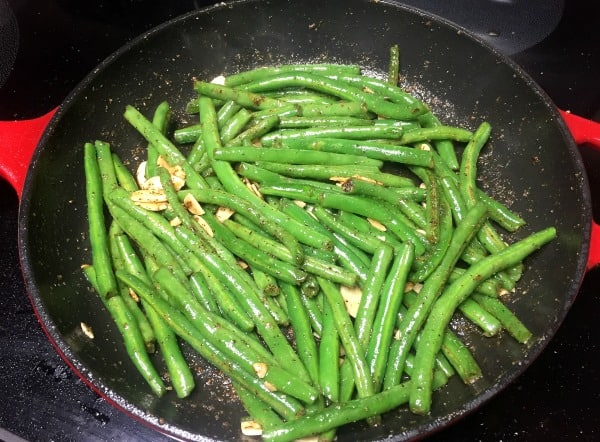 Toasted Sesame Green Beans cooking in a cast iron skillet