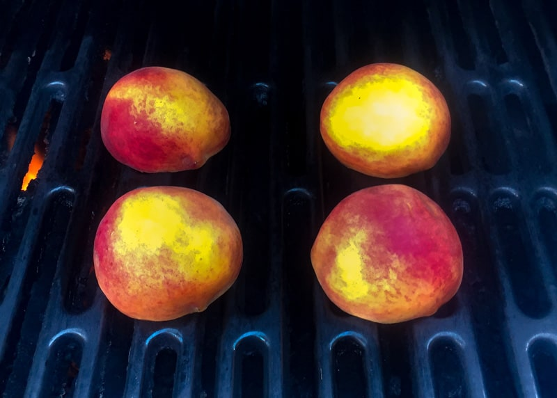 Peaches on grill, cut side down.