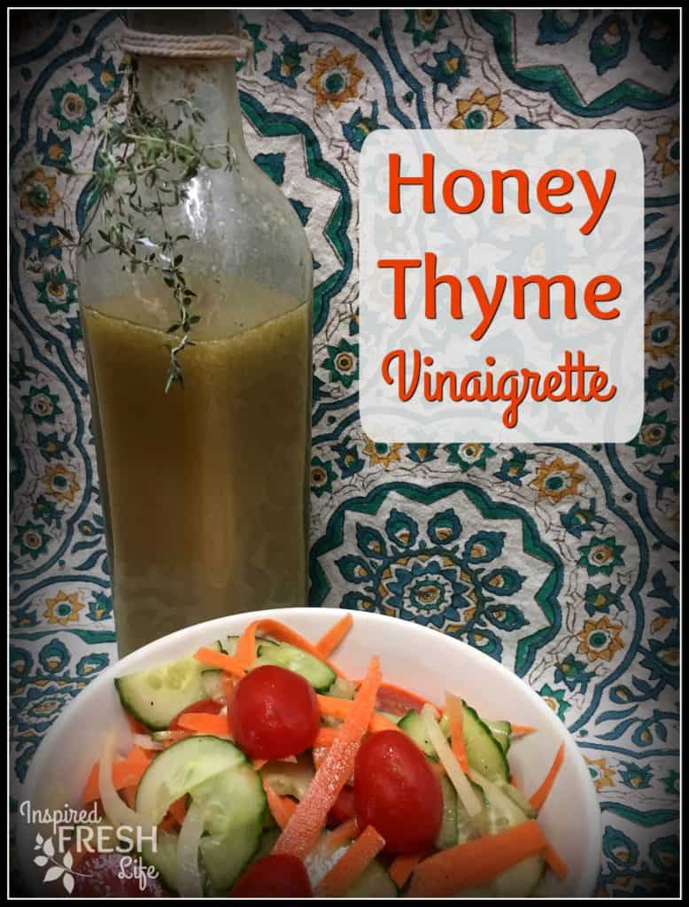 Honey Thyme in a square bottle with a salad in front.