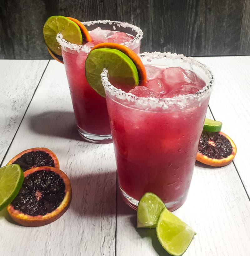 Skinny Blood Orange Margarita garnished with a salt rim and lime and orange wheels.