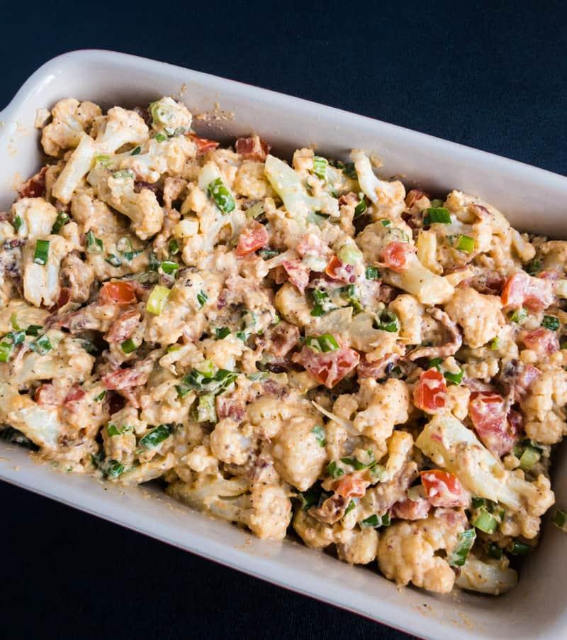 Cheesy Cauliflower Casserole in a casserole dish ready to go in the oven.