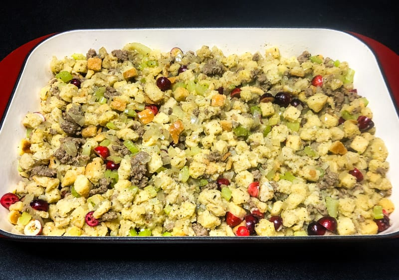 Cornbread Dressing in a large baking dish ready to go into the oven.
