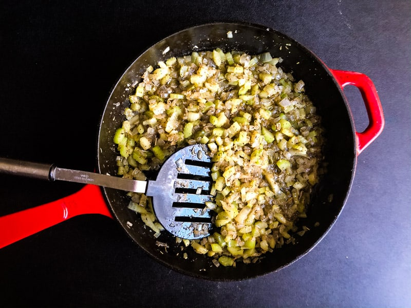 Sauteeing the celery, garlic, and onion in butter with seasonings in a casti iron skillet.