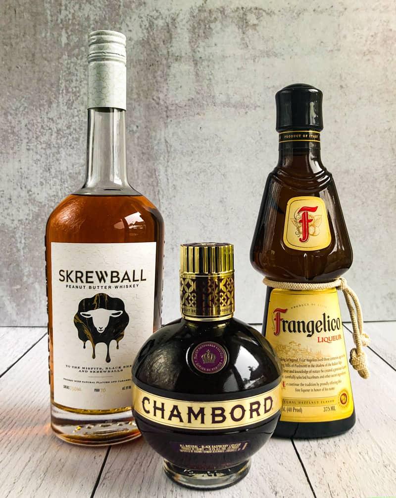 Bottles of Skrewball whiskey, Chambord, and Frangelico