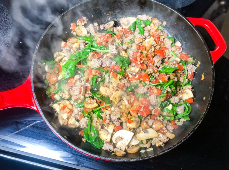 Cooked turkey sausage added to the skillet to heat through.