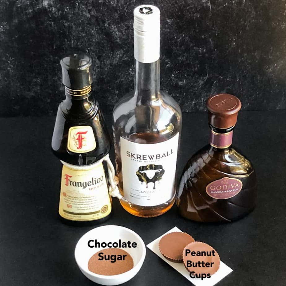 Ingredients to make martini: Frangelico, Godiva chocolate liqueur, Skrewball whiskey, chocolate sugar, and peanut butter cups.