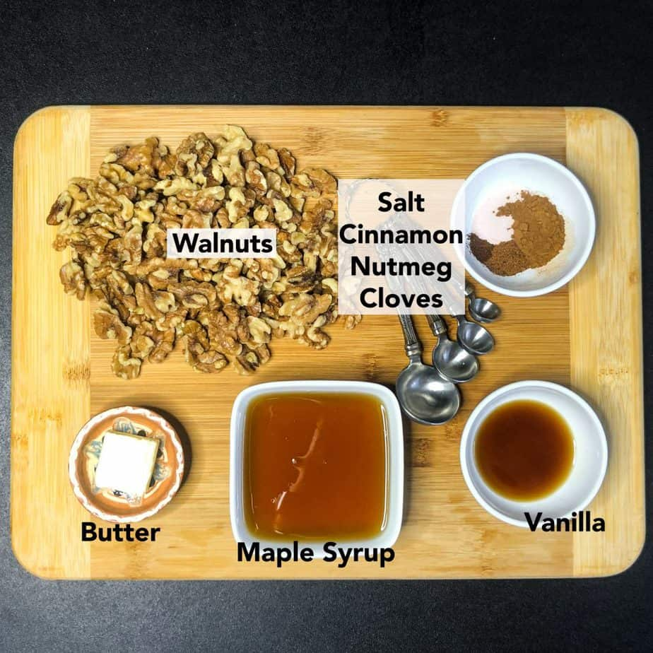 Ingredients for Maple Glazed Walnuts prepped on a wood cutting board.