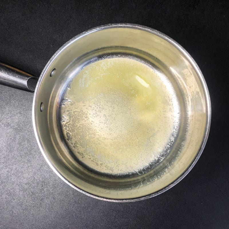 Melted butter in a stainless sauce pan.
