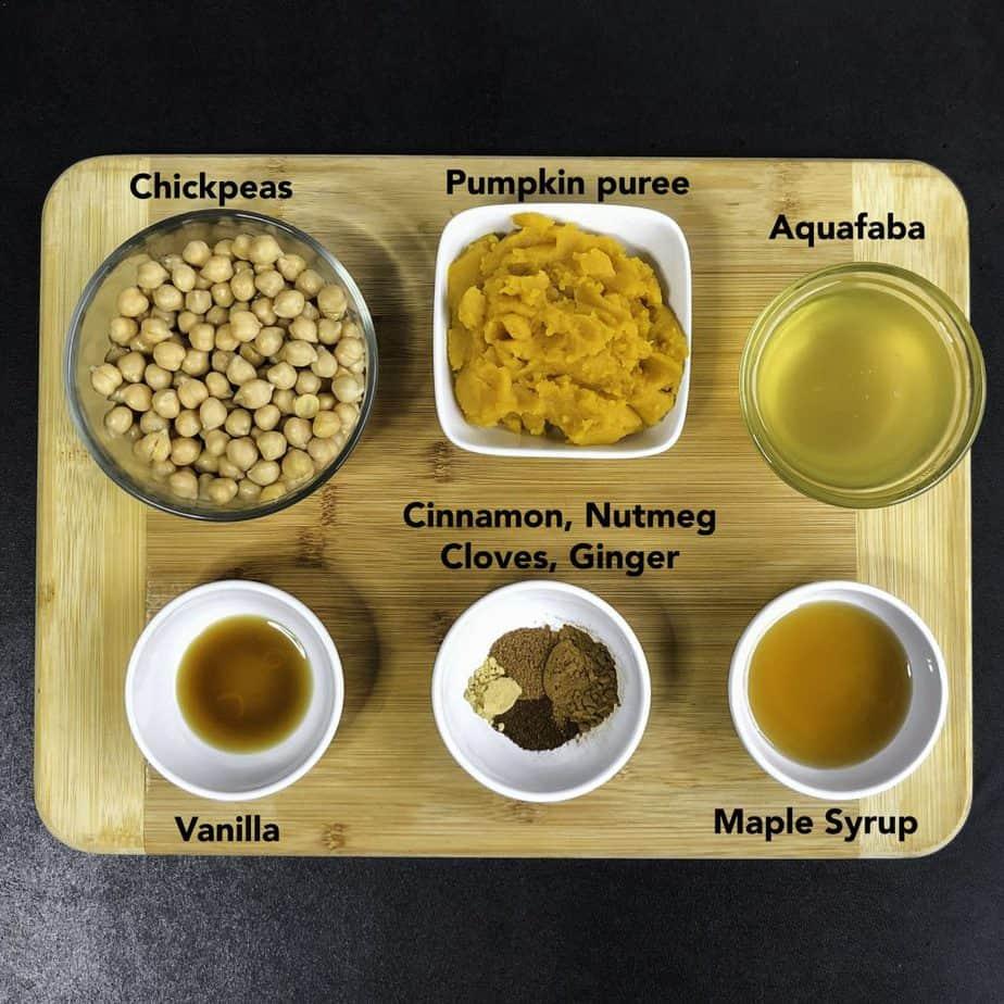Ingredients for Pumpkin Pie Dessert Hummus on a wood cutting board.