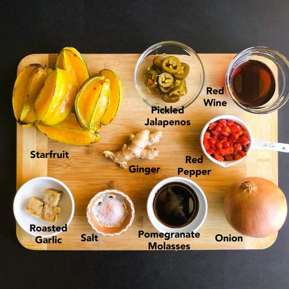 Ingredients for Star Fruit Chutney portioned out on a wood cutting board.