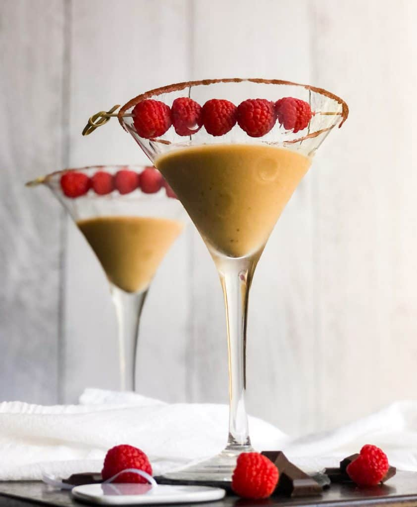 Shoot looking up at Chocolate Raspberry Martini with a sugar rim and garnished with raspberries.