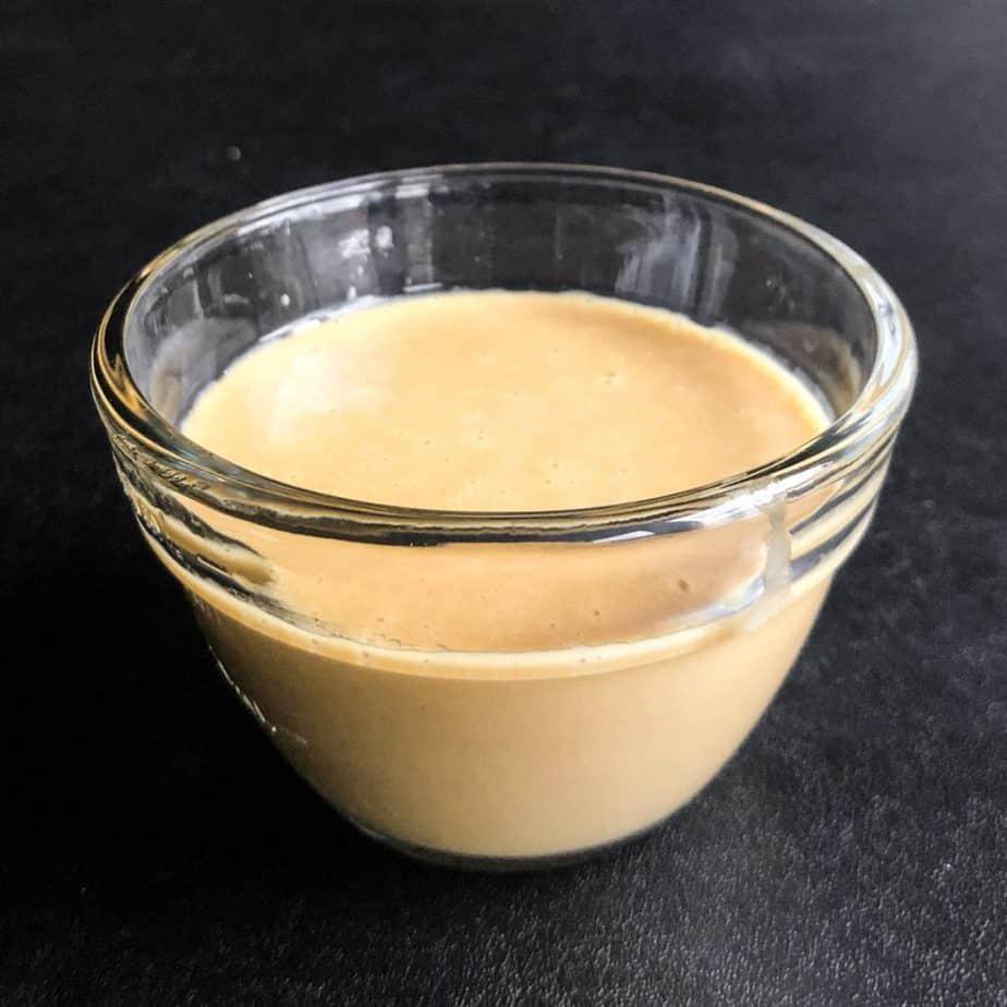 Glass bowl of Miso Ginger salad dressing.