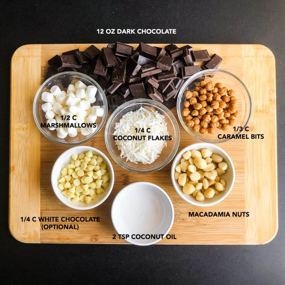 Ingredients for Homemade Filled Chocolates portioned on a wood cutting board.