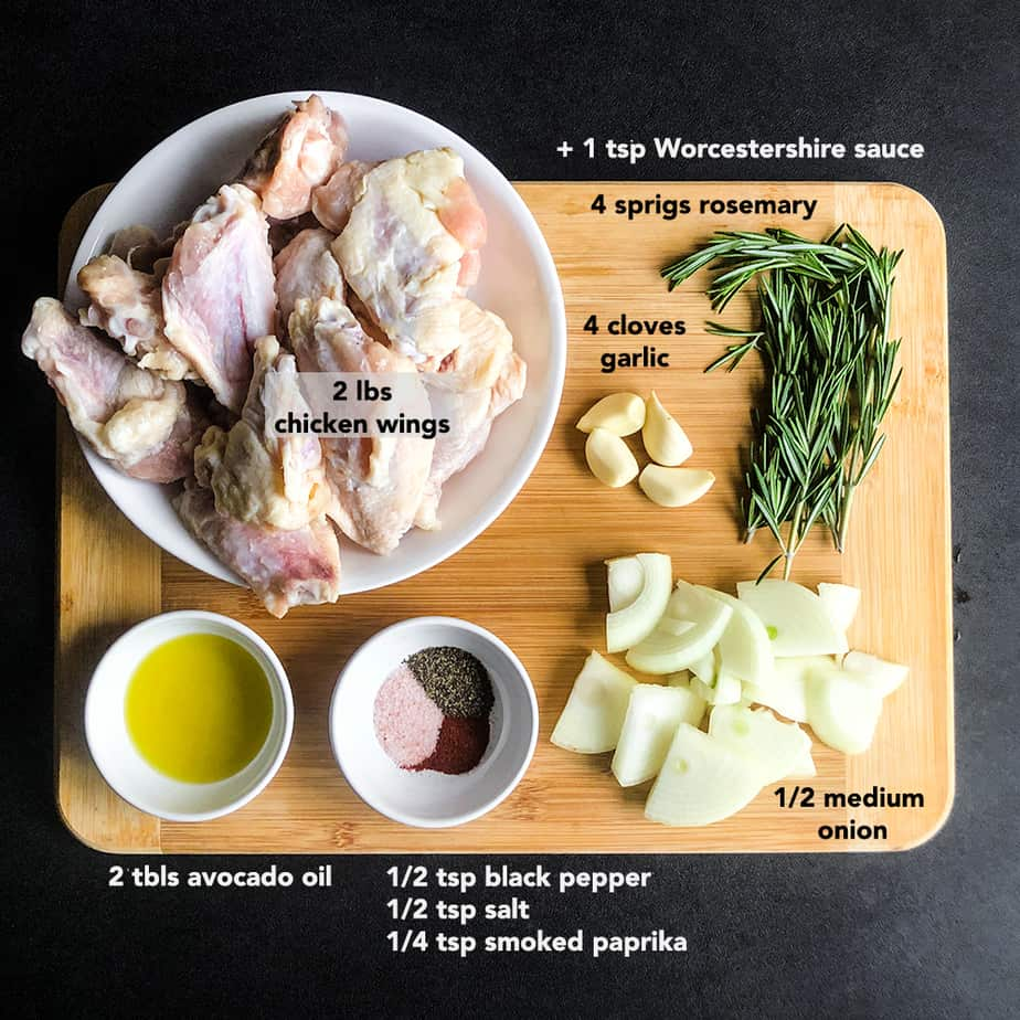 Ingredients for Crispy Smoked Chicken Wings portioned on a wood cutting board.