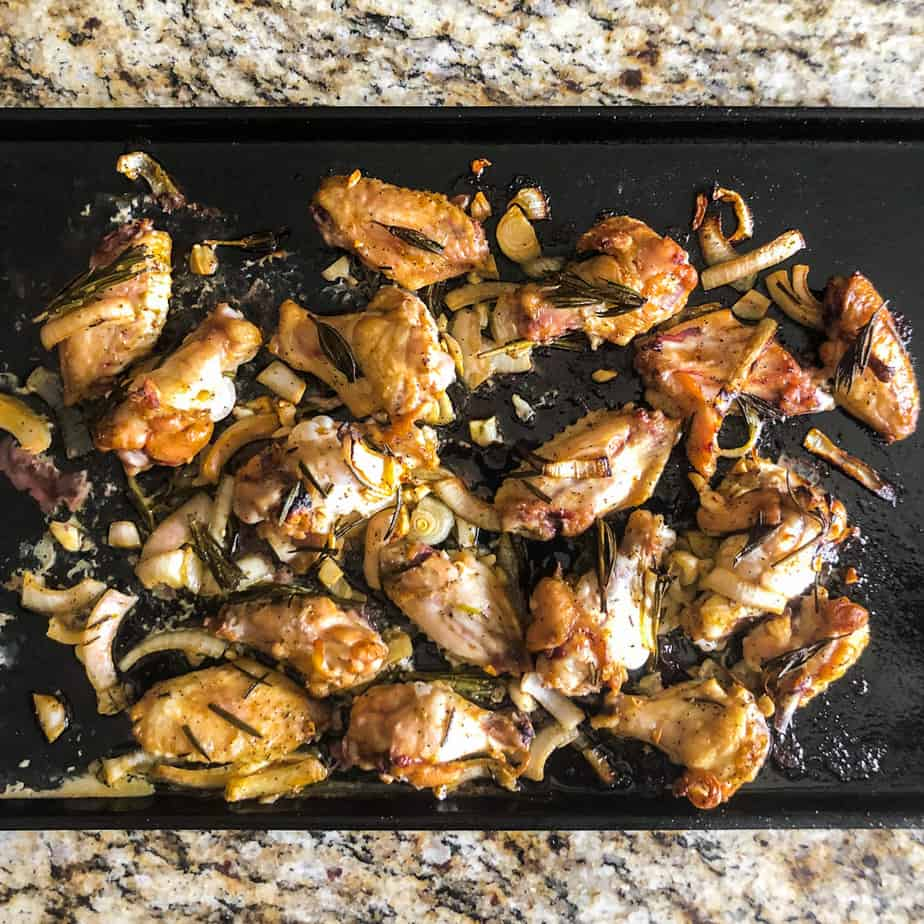 Smoked Wings on a baking sheet ready to be broiled in the oven.